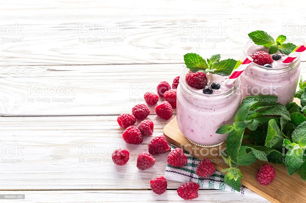 Raspberries fruit smoothie or milk shake stock photo