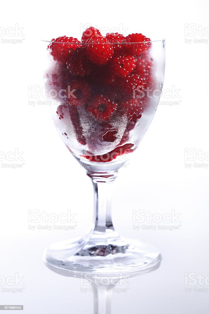 Raspberries in a glass royalty-free stock photo