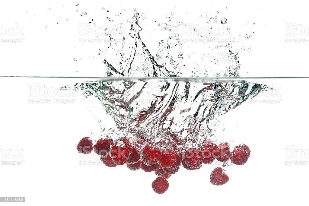 raspberries in clear water stock photo