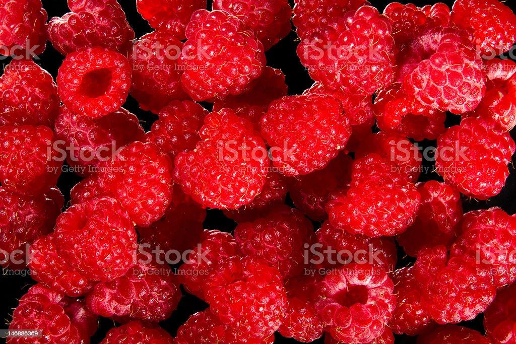 Raspberries on a black royalty-free stock photo