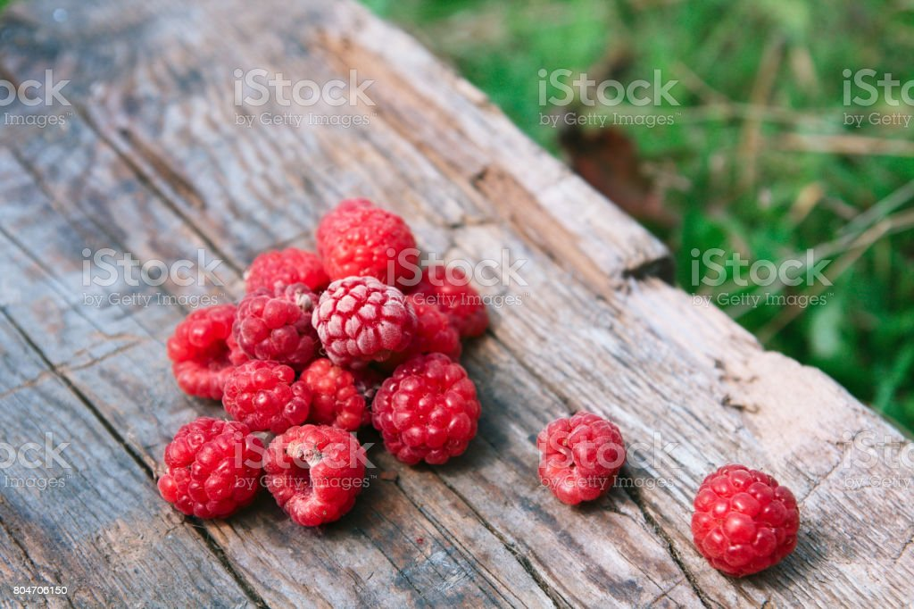 RaspBerries on a wooden surface stock photo