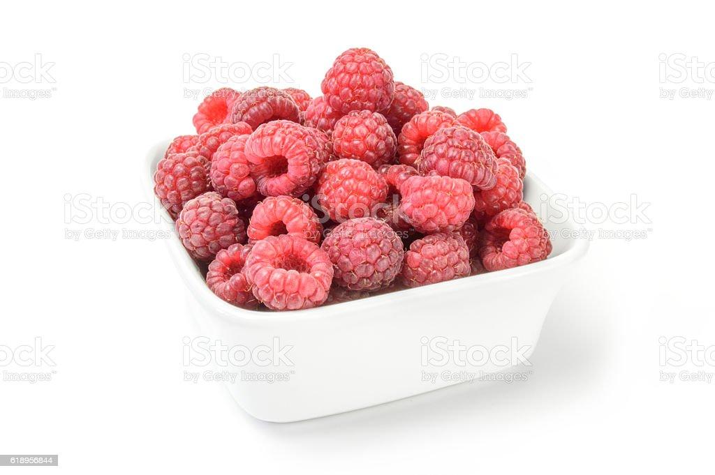 Raspberries on plate over white stock photo