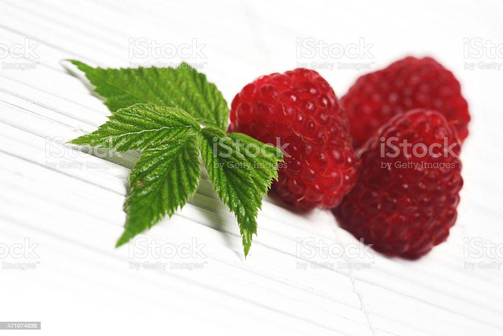 Raspberries on white background - studio shot stock photo