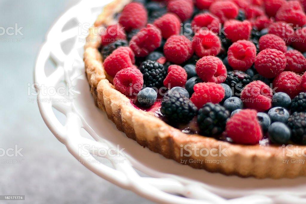 A raspberry and blackberry tart stock photo