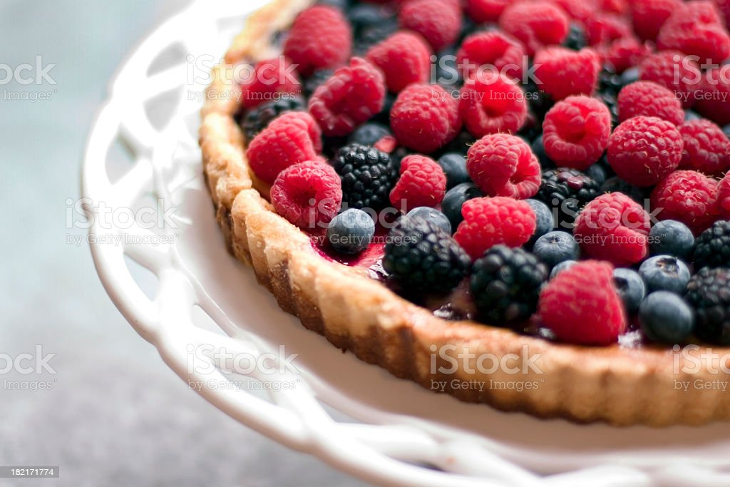 A raspberry and blackberry tart stock photo