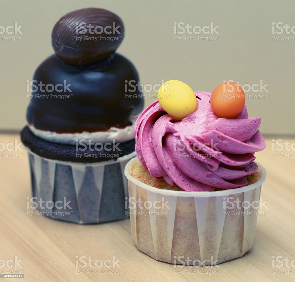 Raspberry and choclate cupcackes stock photo