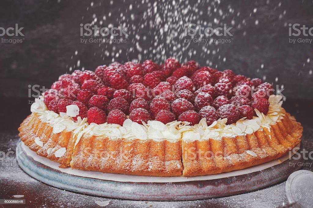 Raspberry and lemon cream tart with fresh raspberries on top stock photo