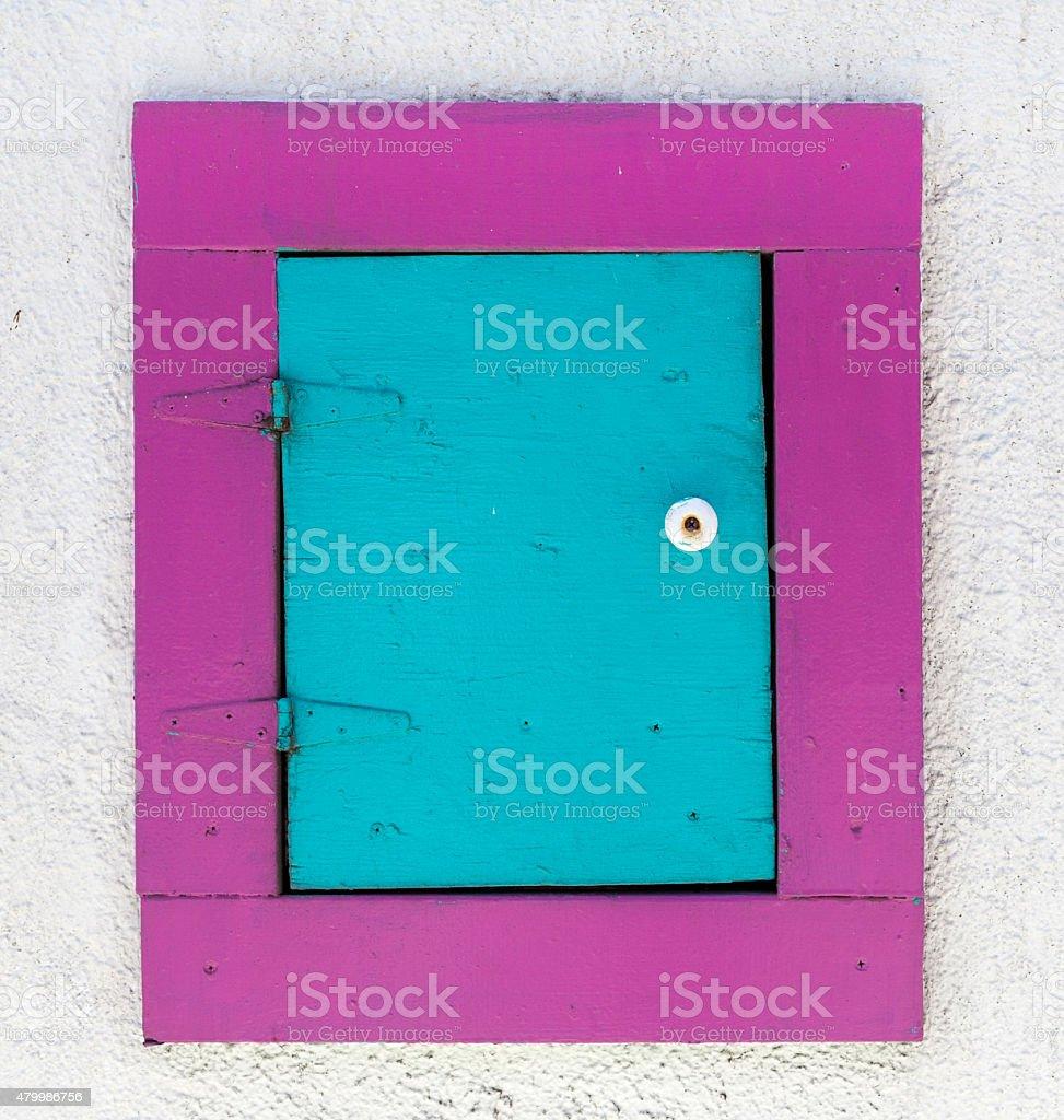 Raspberry and Turquoise Door stock photo