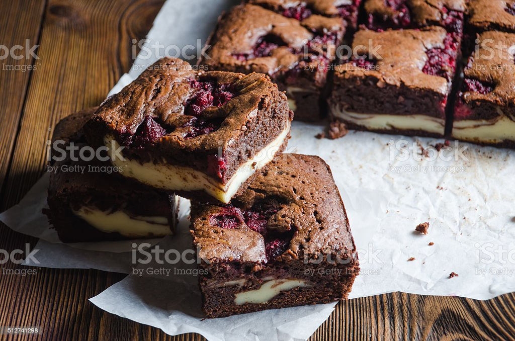 Raspberry brownie on wooden background stock photo