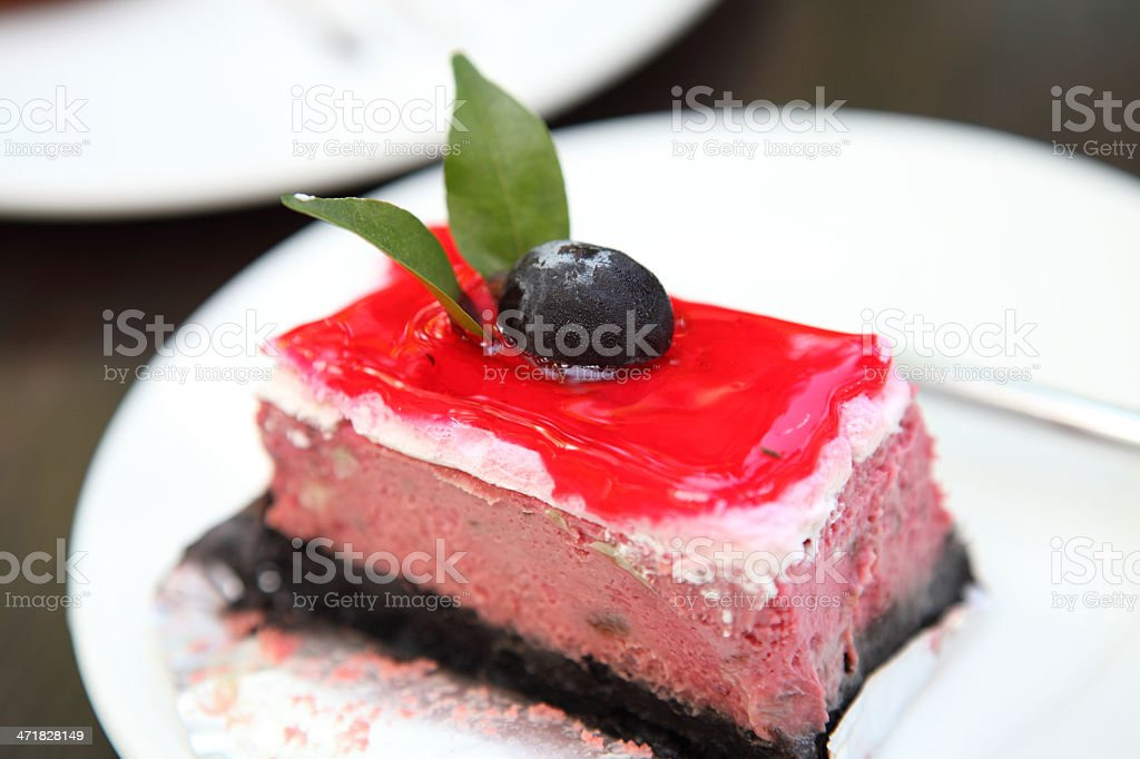 raspberry cake on wood background royalty-free stock photo