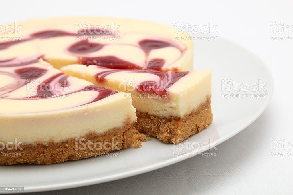 Raspberry cheesecake on a round white plate royalty-free stock photo