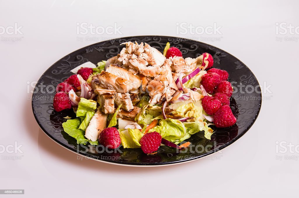 Raspberry chicken salad on black plate stock photo