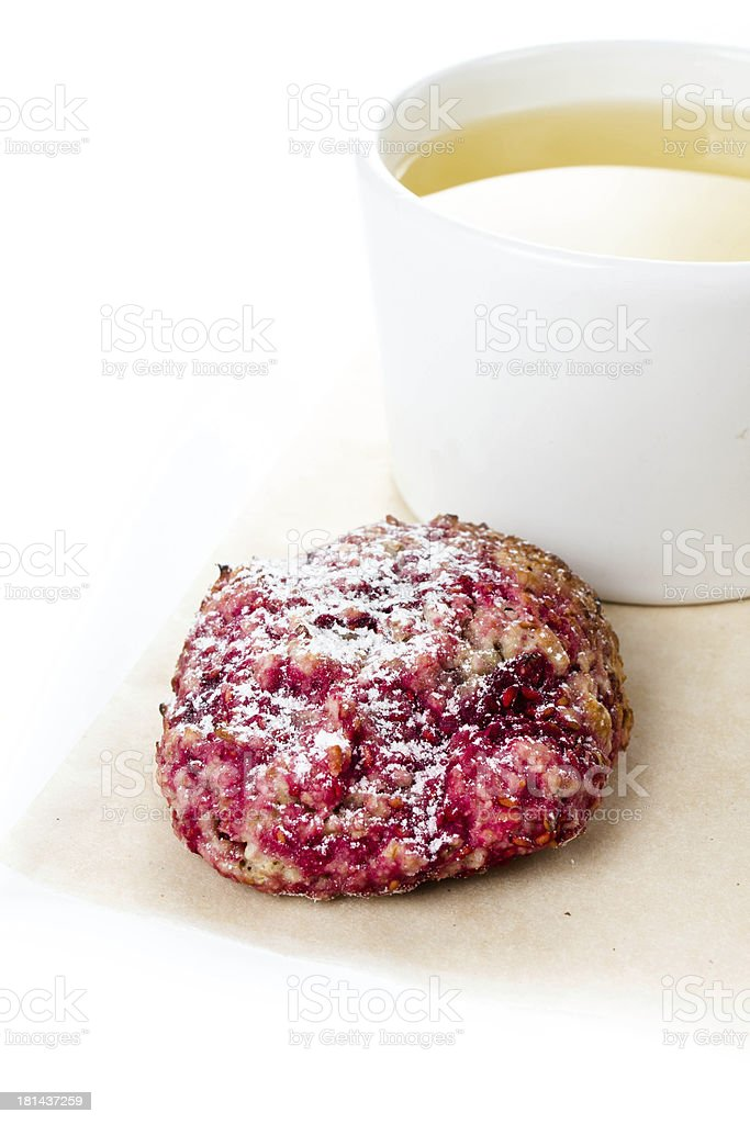 Raspberry cookie with oatmeal and cup of green tea royalty-free stock photo