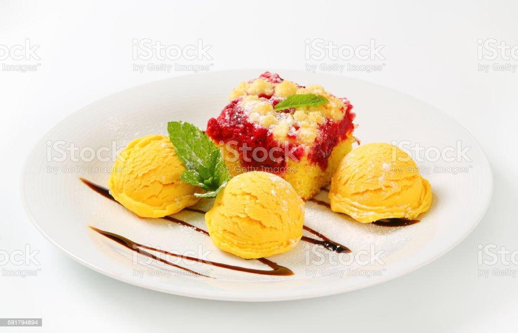Raspberry crumb cake with ice cream stock photo