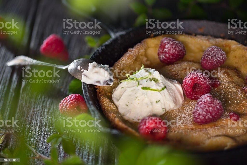 Raspberry Dutch baby pancake stock photo