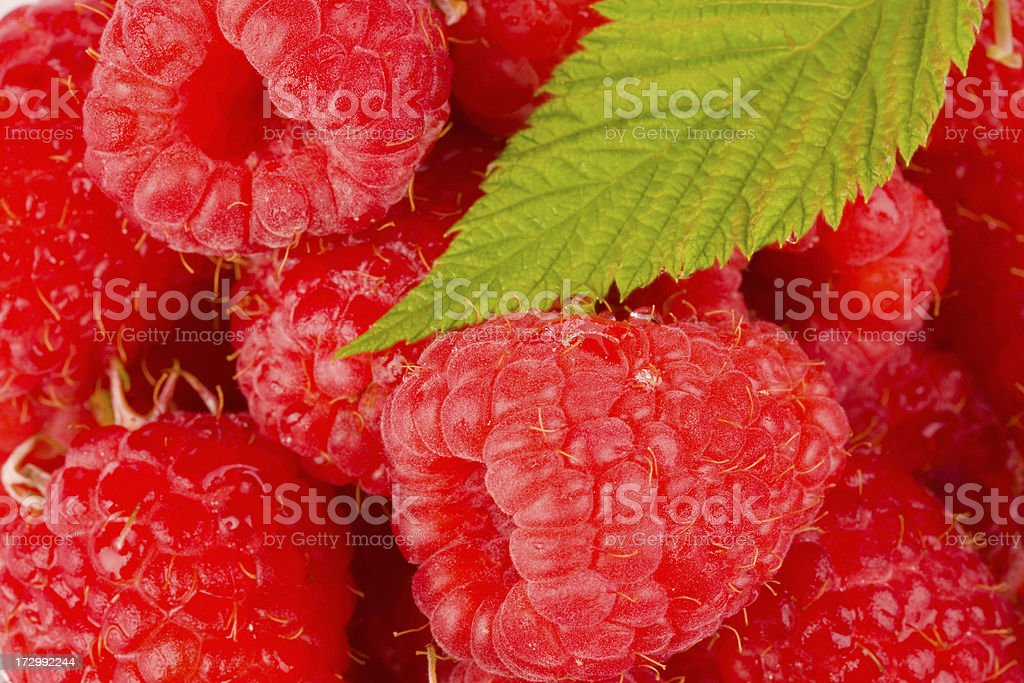 Raspberry heap with Leafs stock photo