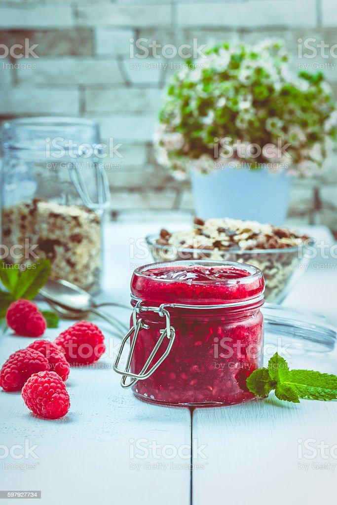 Raspberry jam with mint stock photo