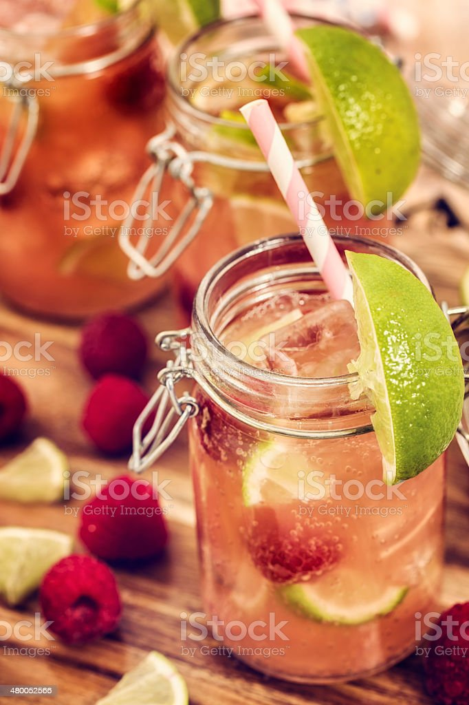 Raspberry Lime Cocktail Served in a Jar stock photo