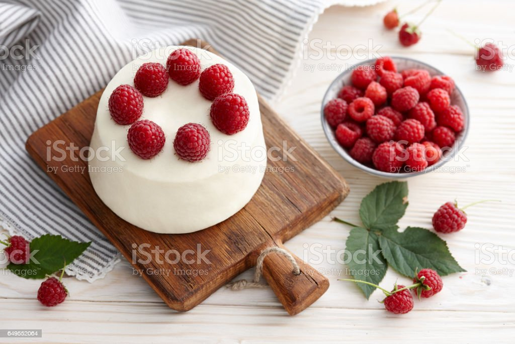 Raspberry mousse cake on wooden board stock photo