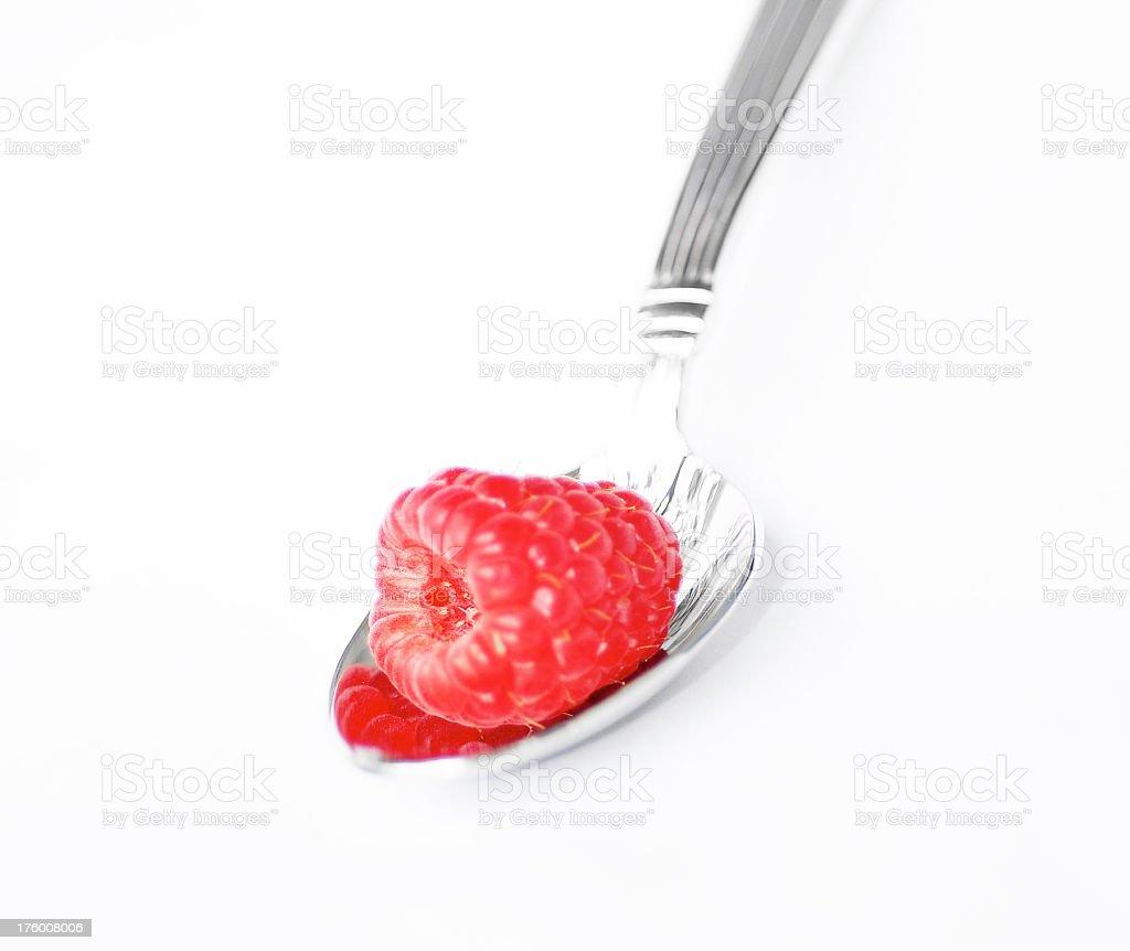 Raspberry on Silver Spoon stock photo
