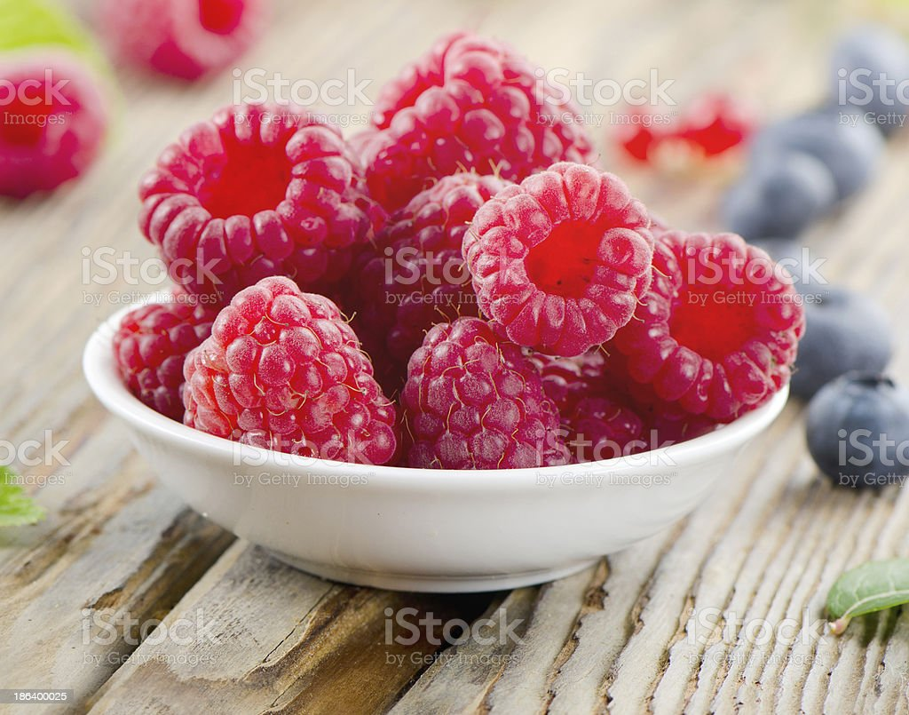Raspberry on wooden table royalty-free stock photo