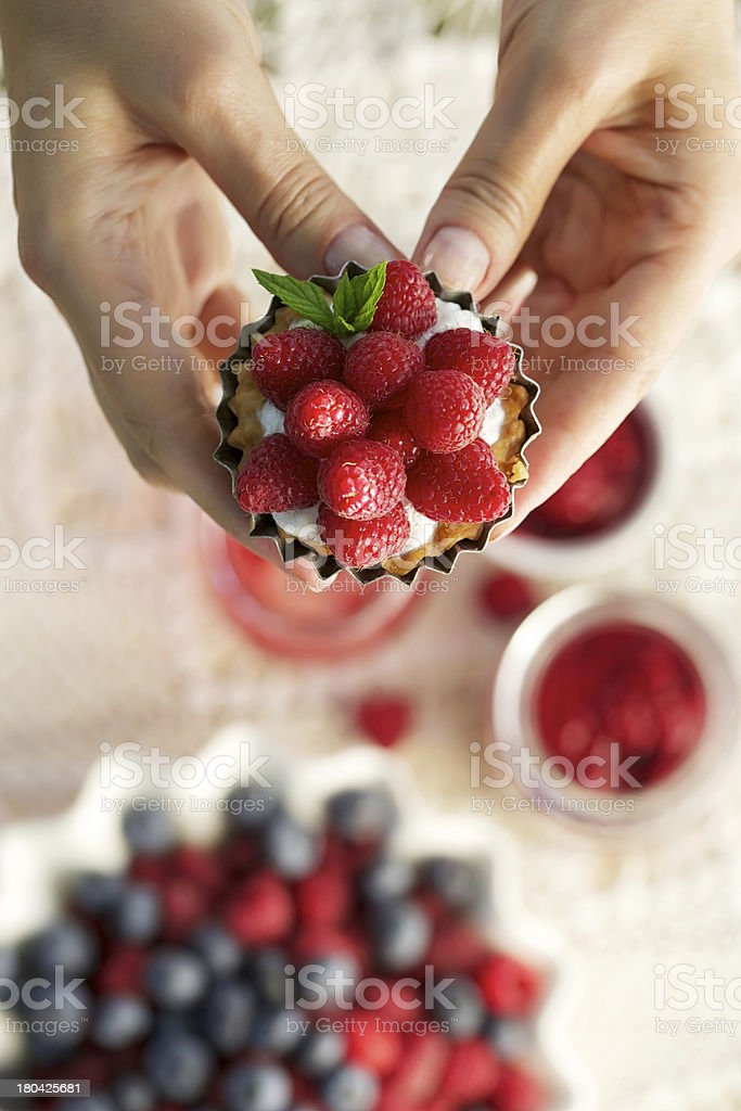 raspberry tart and blueberries stock photo