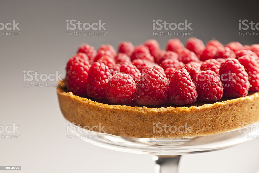 Raspberry Tart on a Glass Cake Stand stock photo