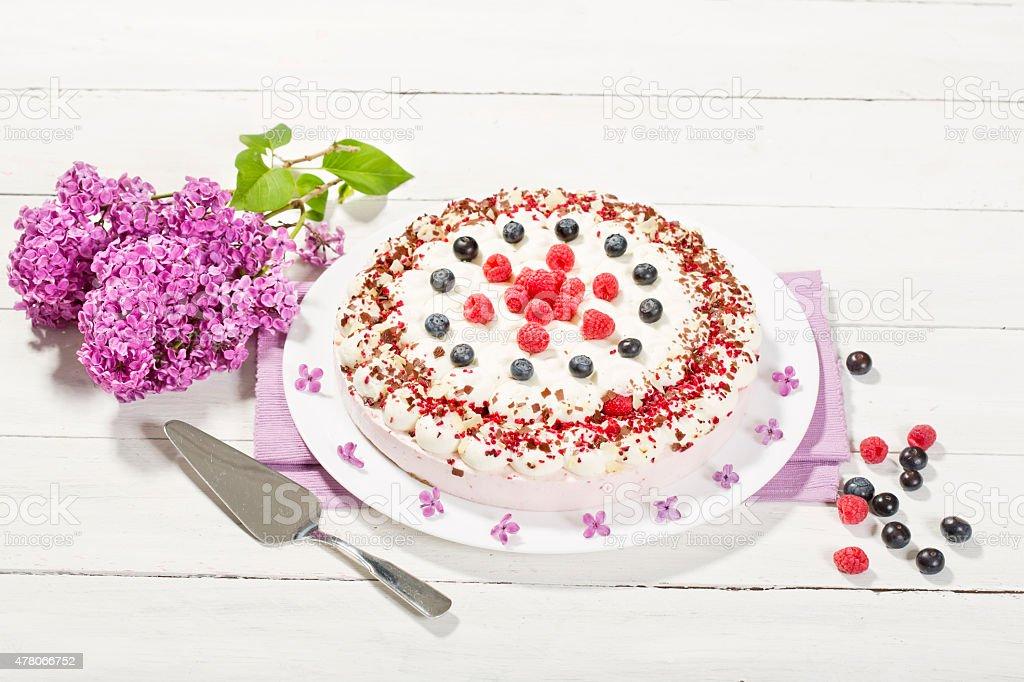 Raspberry-cream cake with raspberries and blueberries stock photo