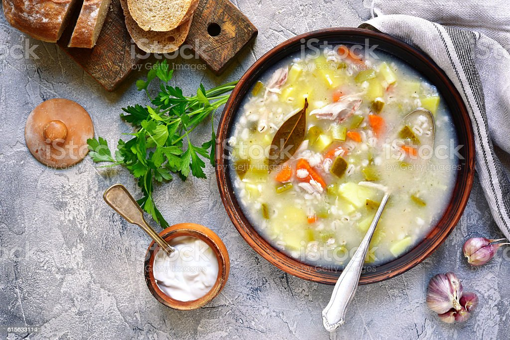 Rassolnik - traditional russian soup with pickled cucumber .Top view. stock photo