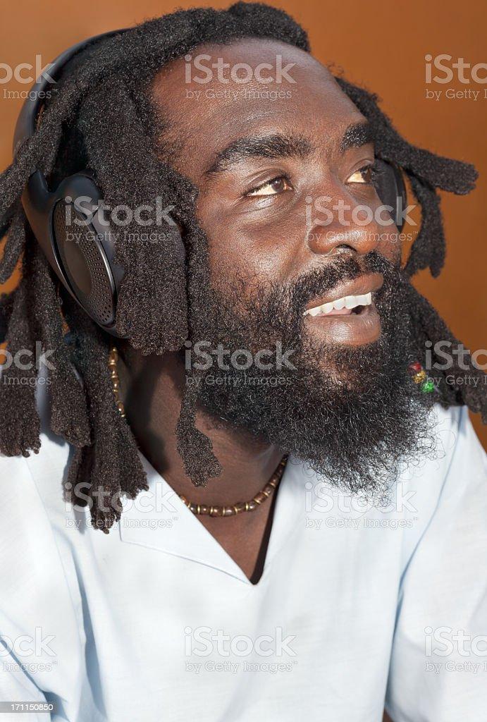 Rastafarian Listening to Music royalty-free stock photo