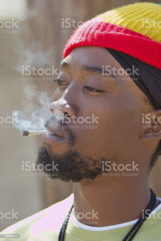 Rastafarian smoking marijuana stock photo