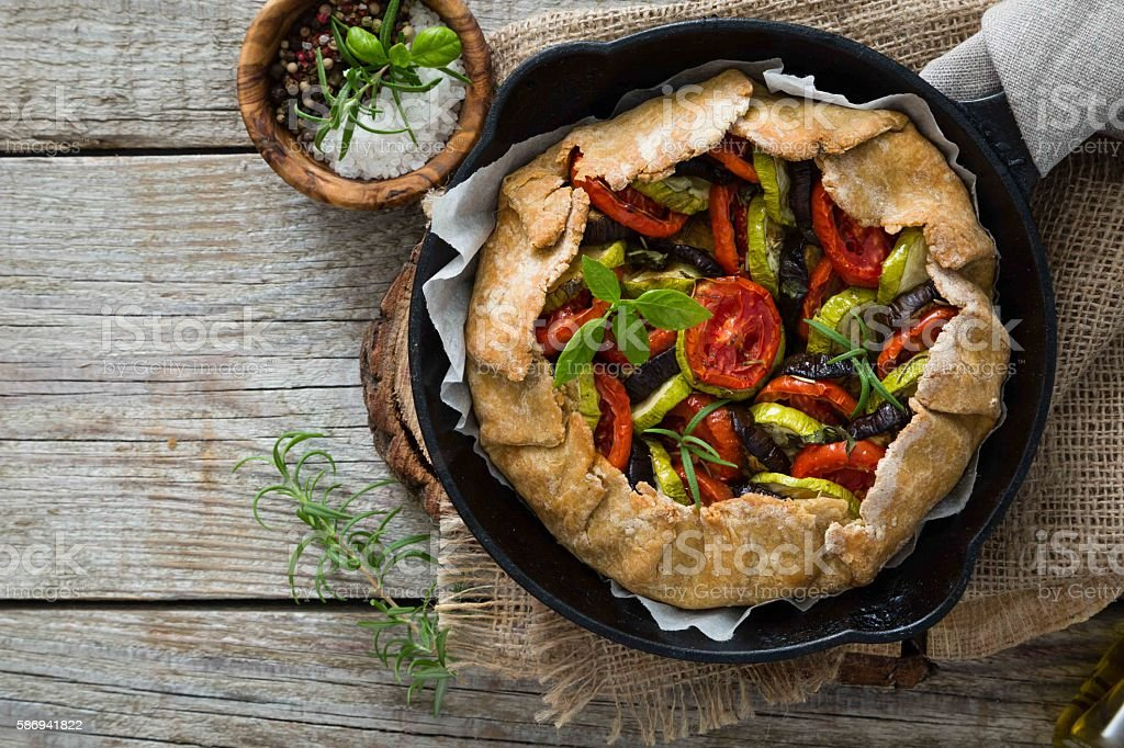 Ratatouille galette pie on rustic background stock photo