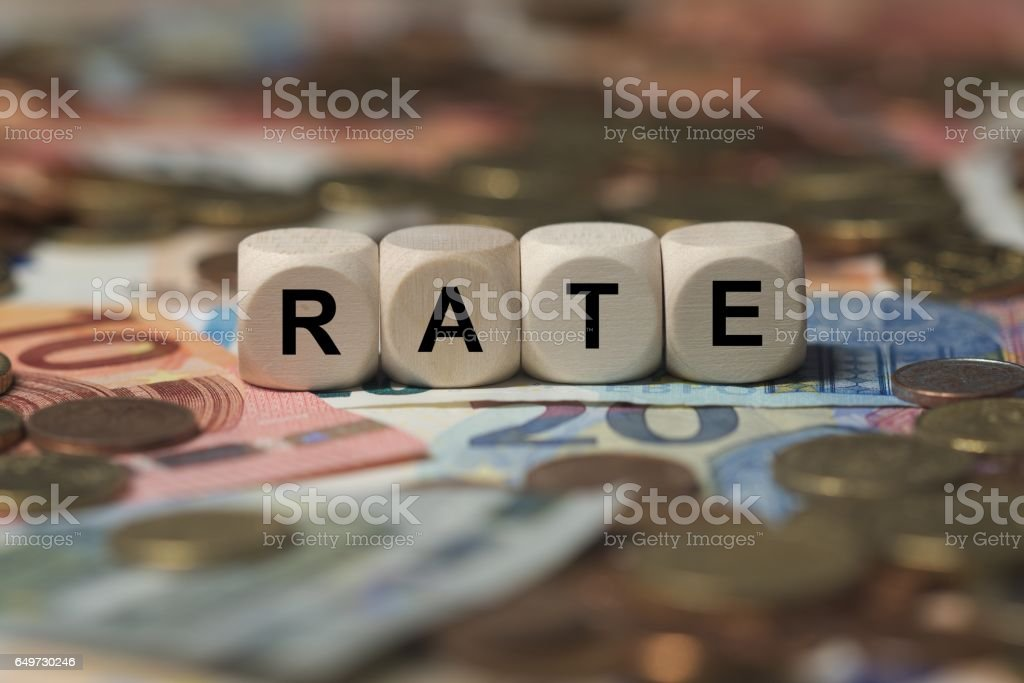rate - cube with letters, money sector terms - sign with wooden cubes stock photo