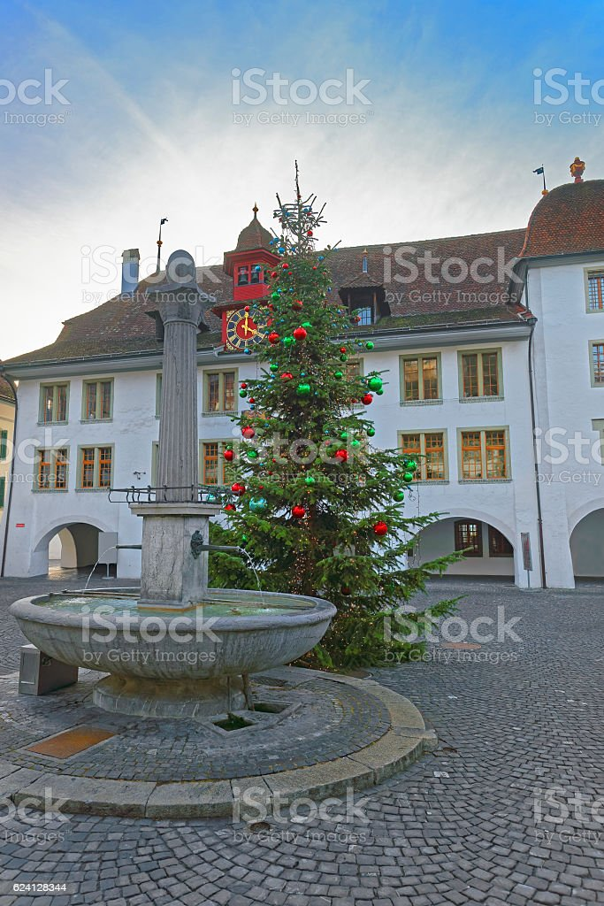 Rathaus hotel and Christmas tree and Fountain in Thun Square stock photo