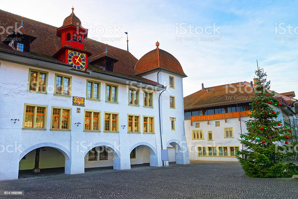 Rathaus Hotel and Christmas tree in Thun City Hall Square stock photo