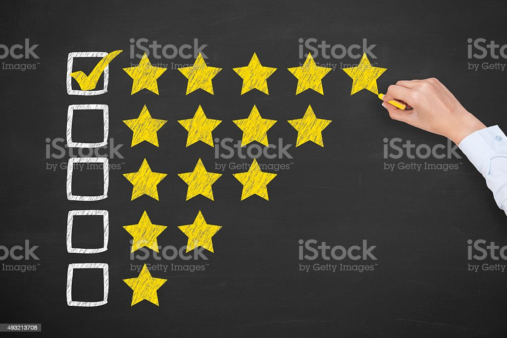 Rating Five Golden Stars on Chalkboard stock photo
