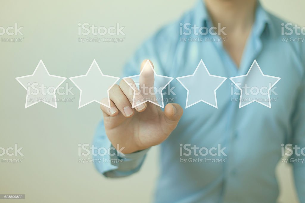 Rating review evaluation feedback concept five stars stock photo