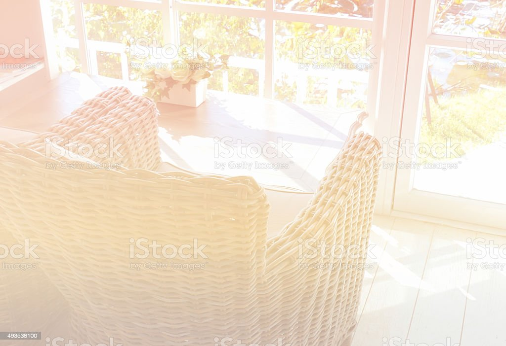 rattan armchair with fabric cushion and pillow stock photo