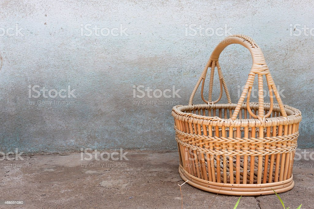 Rattan basket on the cement floor royalty-free stock photo