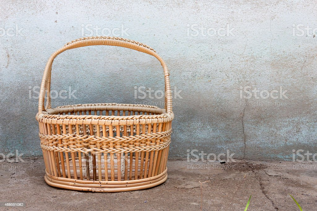 Rattan basket with cement wall background royalty-free stock photo
