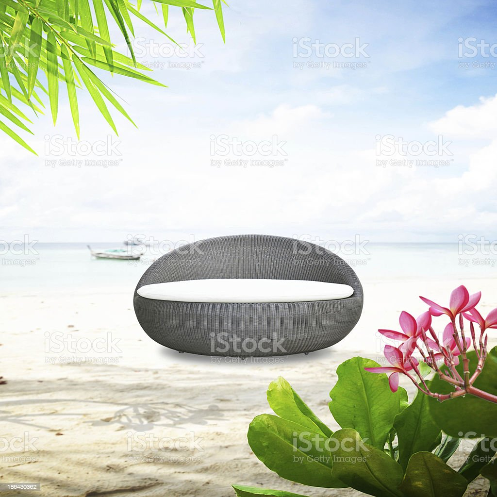 Rattan seat on the beach stock photo