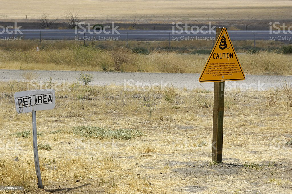 Rattlesnake Warning and Pet Area Signs royalty-free stock photo