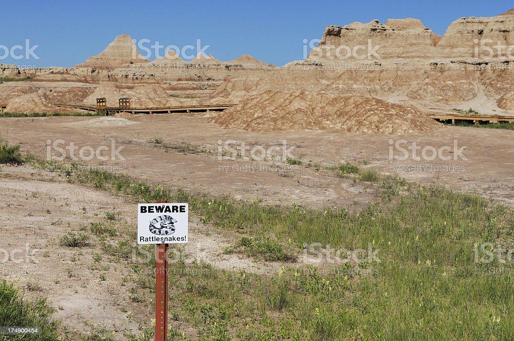 Rattlesnake Warning Sign Badlands National Park Landscape in South Dakota royalty-free stock photo