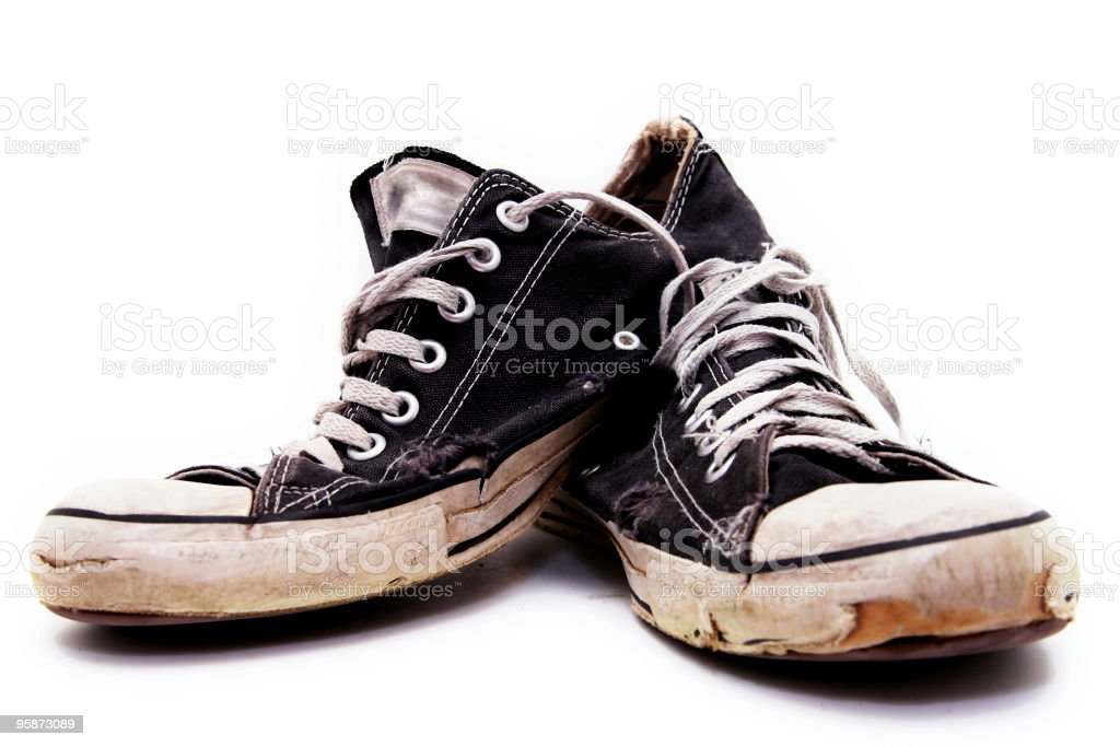 Ratty, old pair of black converse sneakers stock photo