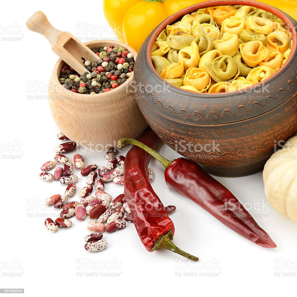 Ravioli in pot of vegetables and spices stock photo