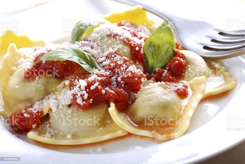 ravioli stuffed with tomato sauce stock photo