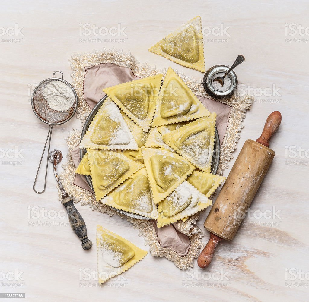 ravioli  Triangoli making set, preparation on white wooden background stock photo