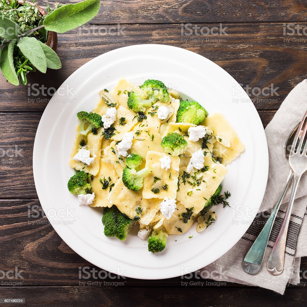 Ravioli with goat cheese, broccoli and herbs stock photo
