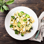 Ravioli with goat cheese, broccoli and herbs
