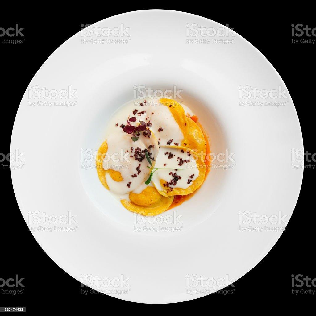 Ravioli with polenta isolated on black stock photo